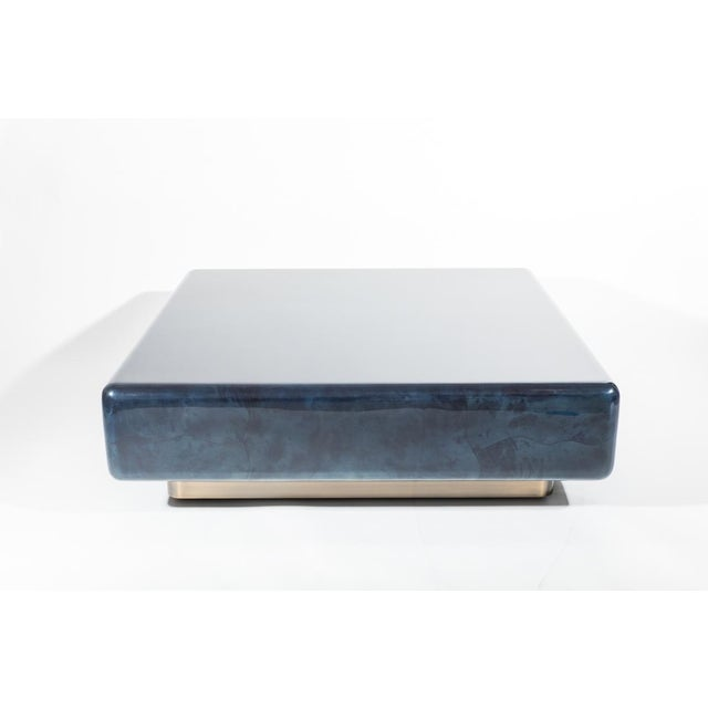 This over-scaled low table is made with free-form inlay of natural goatskin with a polished lacquered finish. Springer's...