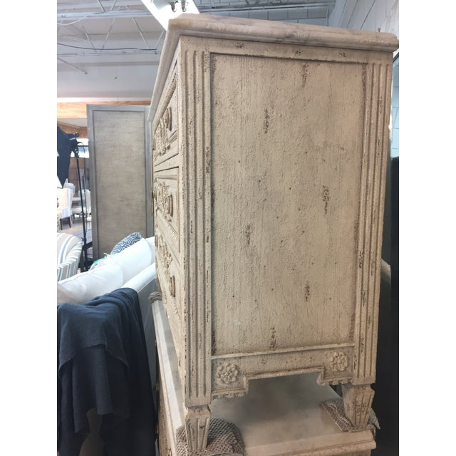The Tarlow is derived form a 19th century Flemish chest. Unique features consist of a distressed ivory marble top with...