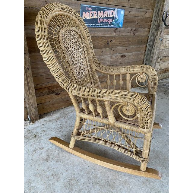 Beautiful and in excellent condition vintage fiddlehead rocking chair with cane seat by Pacific Traders & Manufacturing...