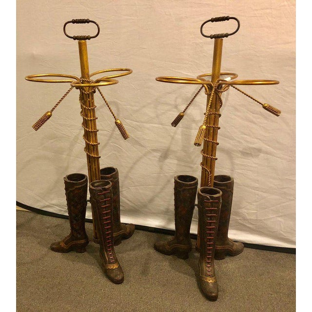 A Pair Of Umbrella Stands Each Depicting Painted Boots On Bronze From Base. Can Buy one at $975.