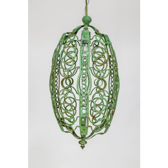 A fantastic, Art Deco, oblong, lantern welded in a circular, cage motif. Painted a beautiful, green color - a faux...