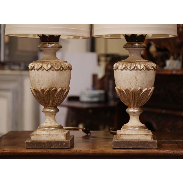 Incorporate extra light into a living room or bedroom with this elegant pair of hand-carved and polychromed neoclassical...