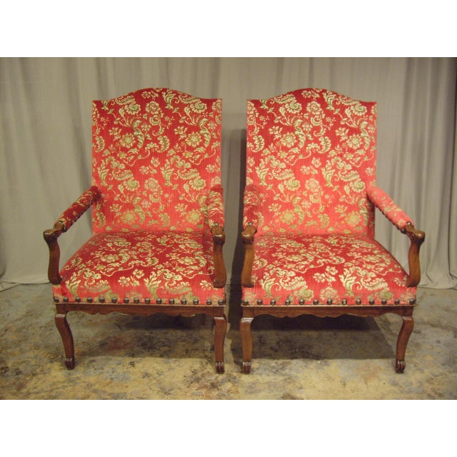 Very elegant large pair of walnut Provincial French Regence' armchairs. Delicate carving and graceful proportions. They...