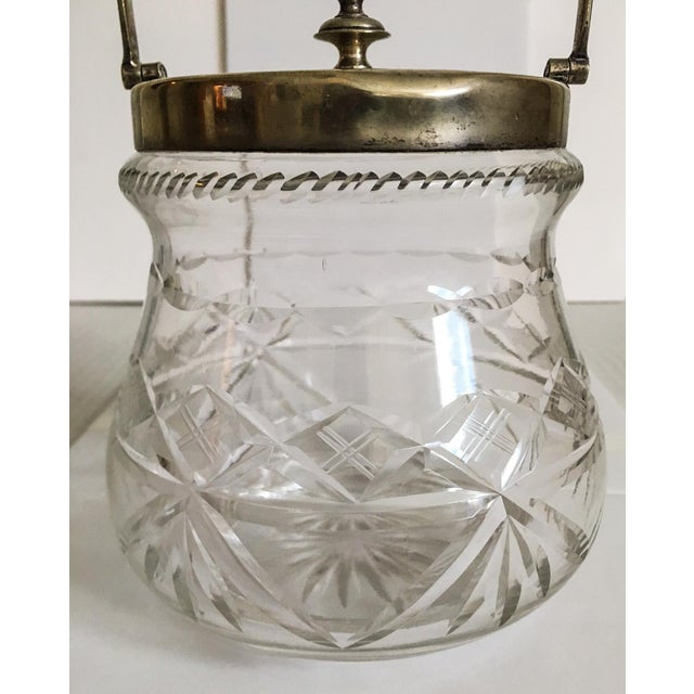 Wonderful deeply cut-glass biscuit jar with an electroplated nickel silver lid and handle by the English firm Slack and...
