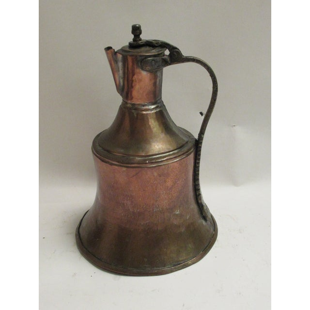 Farmhouse style large hammered copper water pitcher with lid.