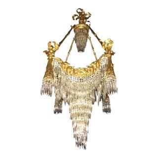 Doré Bronze Louis XVI Style Crystal Ribbon Tassel Drapery Chandelier For Sale