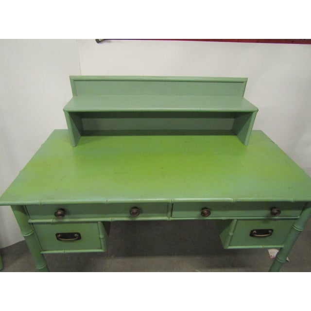 Vintage Faux Bamboo Desk in old green paint. The desk has a matching shelf sitting on top (not attached) . This piece is...