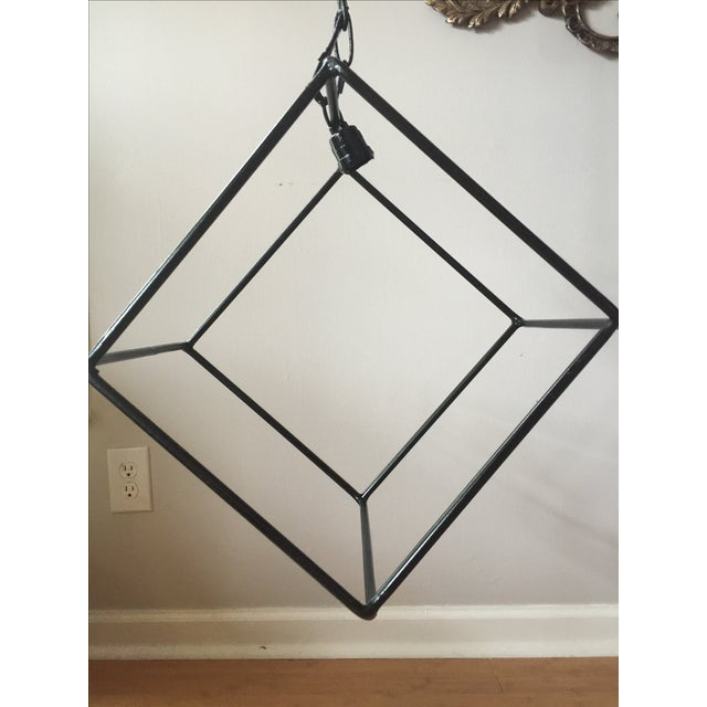 Hand-forged, geometric iron chandelier.