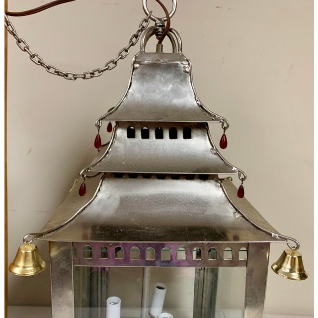This light fixture does not appear to be terribly old, but it does pack a punch with style. It is in working order and...