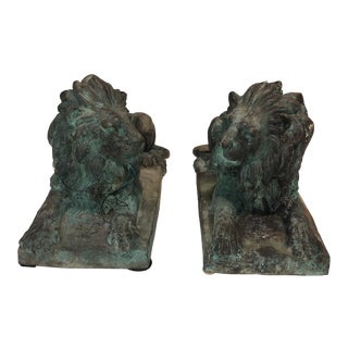Patinated Bronze Recumbent Lions - a Pair For Sale