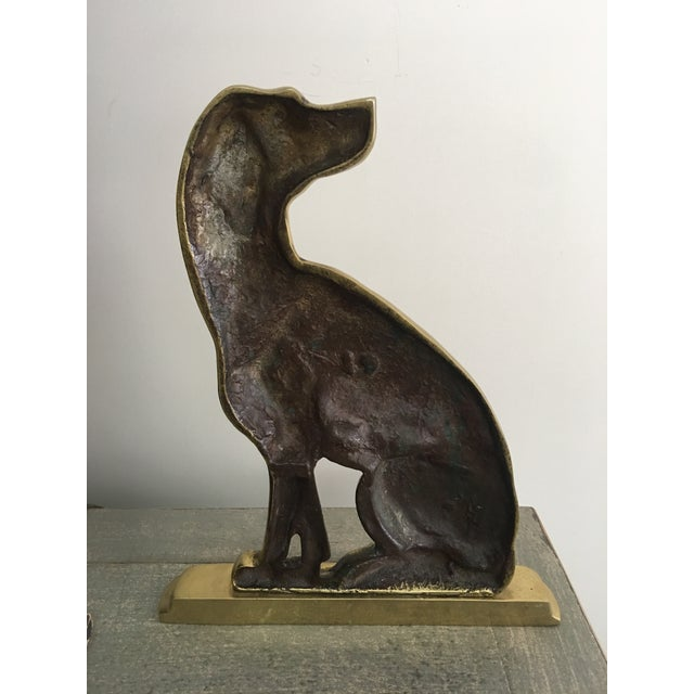 Mid-century solid brass doorstop in the form of a seated dog made by Harvin Brass. This very good boy is perfect for dog...