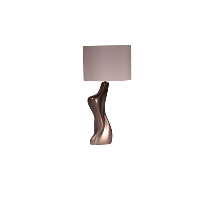 "Helen table lamp is a dynamic shape table lamp with gold finish. Dimension of the table lamp is 8"" L x 6"" W x 19"" H. Shade..."