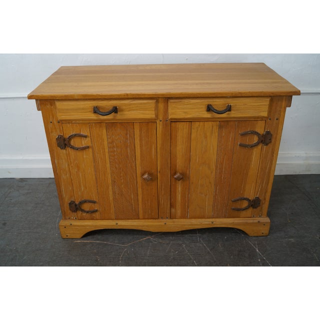 This is a high quality, American made, iron hinged sideboard by 'Brandt Ranch Oak'. Piece was made in America...