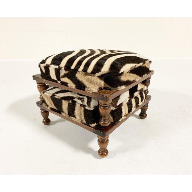 Upholstered in beautiful zebra hide, these handy footstools are the perfect accent piece. We love that they can stack too....