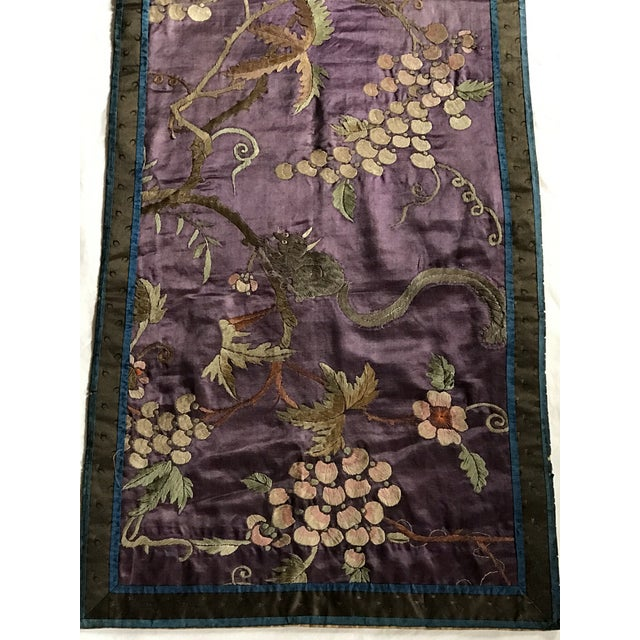 An antique Chinese embroidered Silk textile or runner in a wonderful Plum color. Stunning embroidered berries, flowers and...