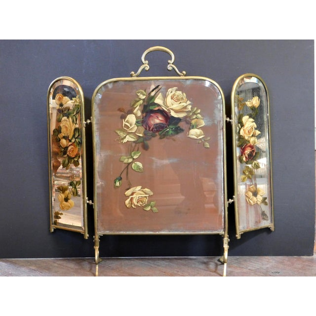 This sweet hand painted mirrored fireplace screen is a great way to cover the fireplace when not in use. Features a Brass...