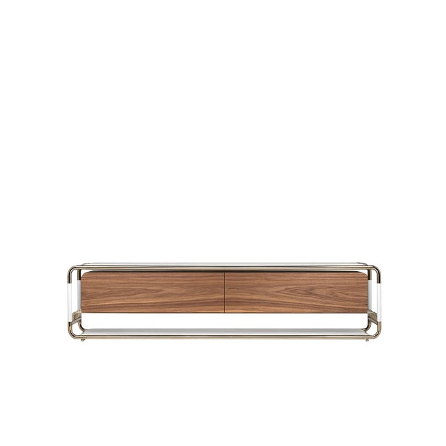 Lautner is a TV table that uses a tubular polished brass frame structure as a support. It combines clean lines with the...