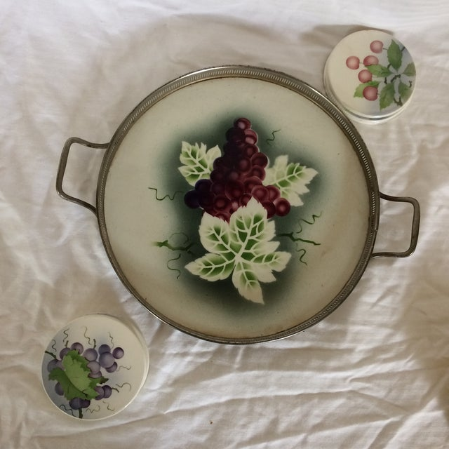 Very nice vintage porcelain and silver plated Serving tray and 8 coasters. The tray has hand painted grape design. Four...