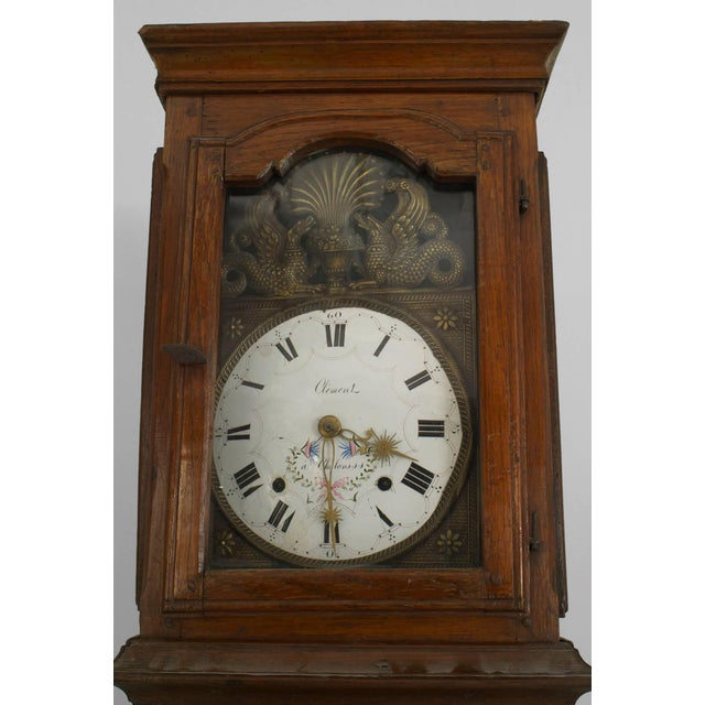 French Provincial (18th Cent) oak grandfather clock with an enamel clock face having metal griffins (Non-operational).