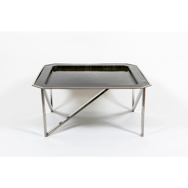 Marble printed lacquered parchment table top over chrome base.