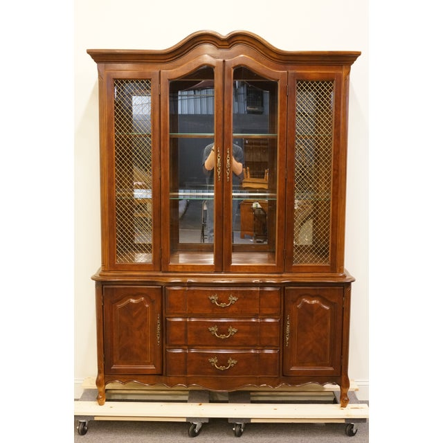 Bernhardt Furniture French Provincial lighted china cabinet. We specialize in high end used furniture that we consider to...