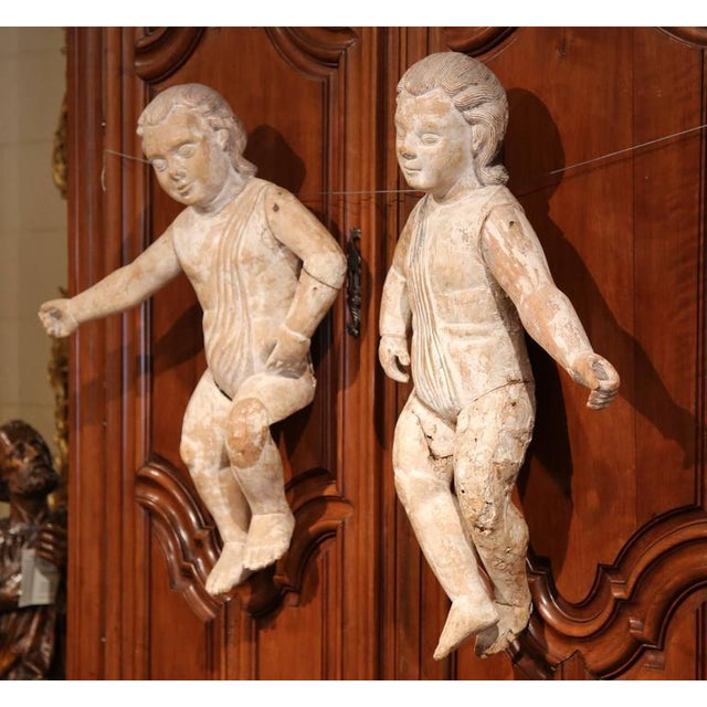 This large pair of antique putti sculptures were crafted in Italy, circa 1760. A putto (plurial putti), is a figure in a...