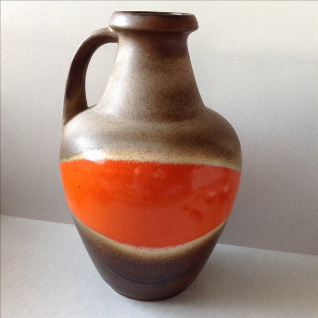 Extra large fat lava jug made by Bay Keramics in W. Germany. Features a bright high gloss stripe around the belly of vase...