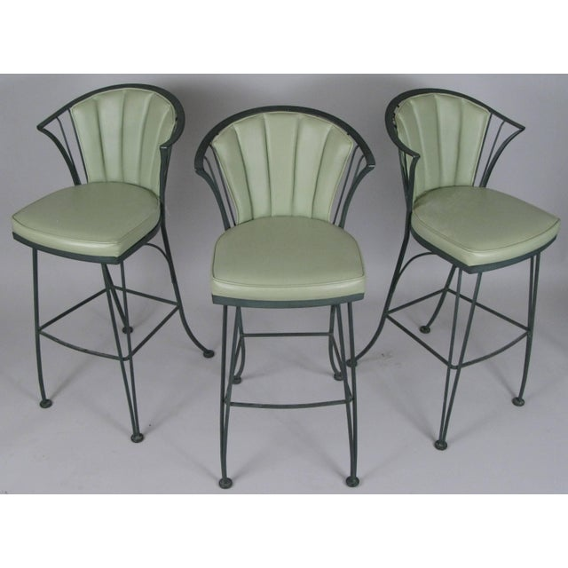 A set of three vintage 1960s wrought iron barstools from the Pinecrest collection by Woodard. Beautiful stylish design...