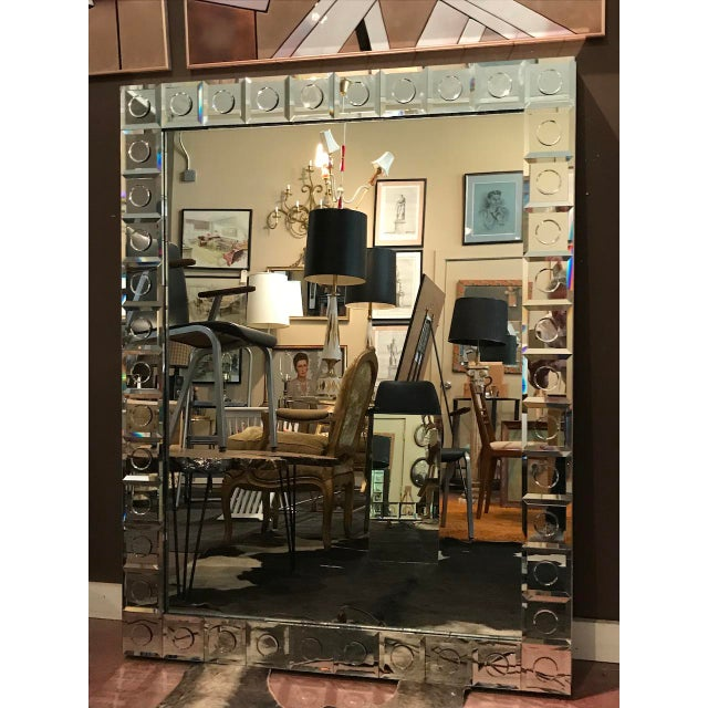 Groovy large-scale mirror, probably custom, with mirrored circle frame, and stainless steel surround at back.. Can be hung...