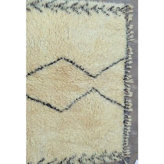 The large, archaic looking, white-ground rug known as the Beni Ourain is the creation of Morocco's mountain nomads. The...