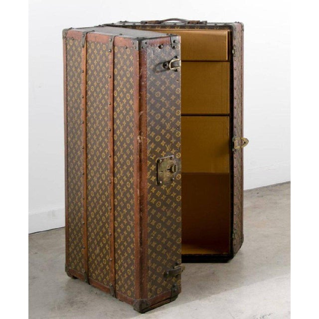 Louis Vuitton, early 20th century Vintage steamer wardrobe trunk, the interior fitted with drawers and hangers Brass lock...