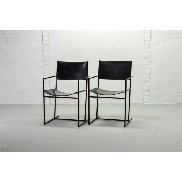 Set of two original Dutch design dining chairs AG-6, designed by the artist Albert Geertjes and produced in 1984. The...