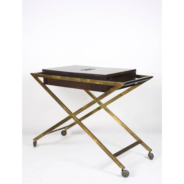 Expandable rolling bar cart or server by John Widdicomb, 1960's. Solid brass X-base frame, walnut fold-out top with...