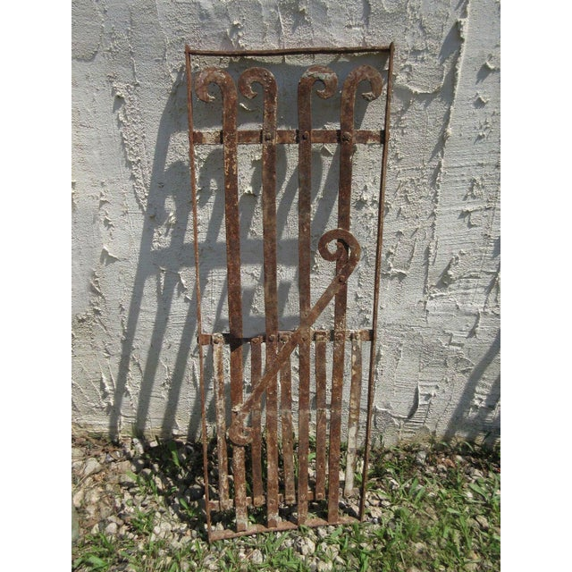 This antique Victorian iron gate is a wonderful piece of architecture. Heavy, tight and sturdy. Piece does show signs of...