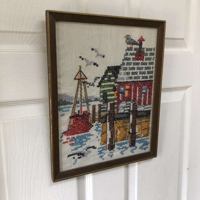 This vintage dockside crewel embroidery scene features a unique wide stitching pattern and keen attention to detail. It is...