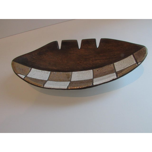 A large mid century modern ceramic ashtray by Jaru of California. Gorgeous browns, white, and gold. Very collectible.