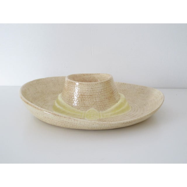 Fun ceramic party platter designed to hold chips and dip or veggies. Made in the shape of a large hat. No makers marks.