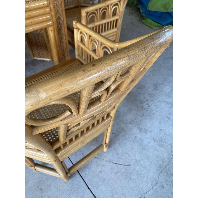 Set of four Brighton Pavilion style rattan chairs with a rattan and wicker weave table base. The base is very cool and...