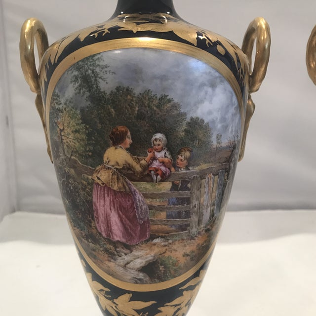 Pair of hand painted by artist B. Foster. Made in England in the 19th century.