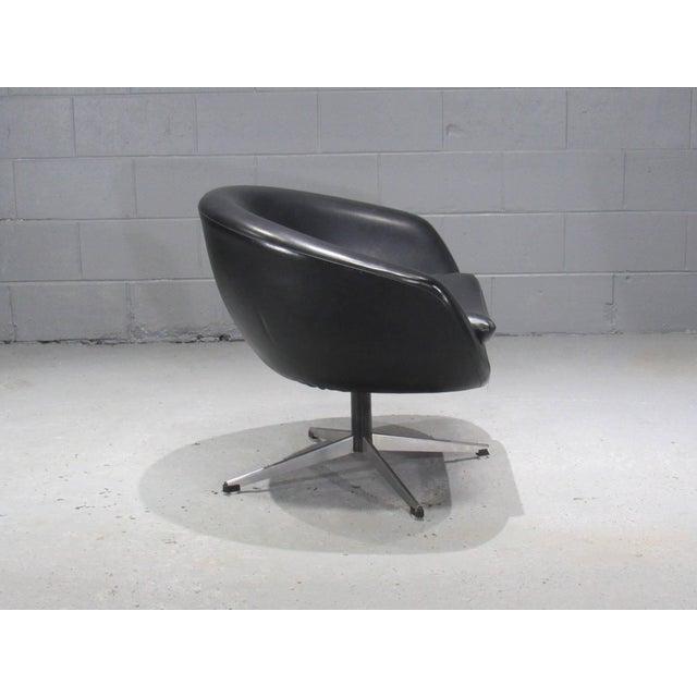 Black swivel pod chair by Overman.
