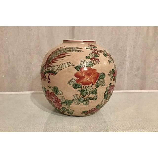 Fabulous Vintage Chinoiserie Vase Floral and Bird Motif on a Peach Colored Background. Hand crafted in Macau. Lovely mix...