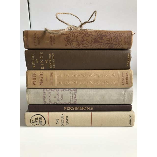 House Of Hipsters curated collection of vintage and antique books in neutrals, yellows, reds, and brown tones. Earthy...