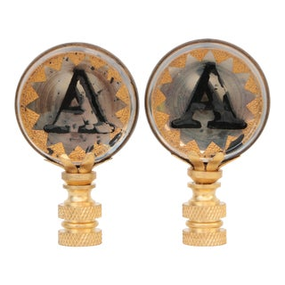 A Monogram Lamp Finials - a Pair For Sale