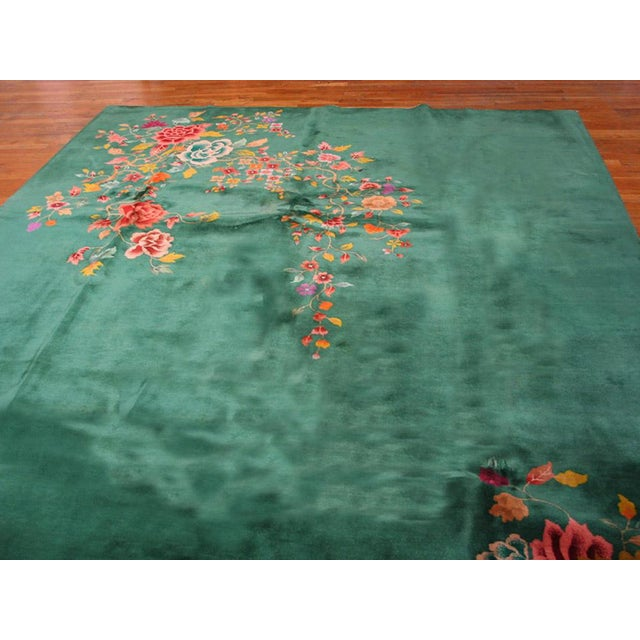 "This is a Chinese art wool rug from China 1920. The size is 8'10""x11'3"". The color is green with patterns in green, pink,..."