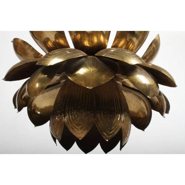 This is the large version of the Feldman Lighting Company's brass lotus chandelier, original brass patina. Three small...