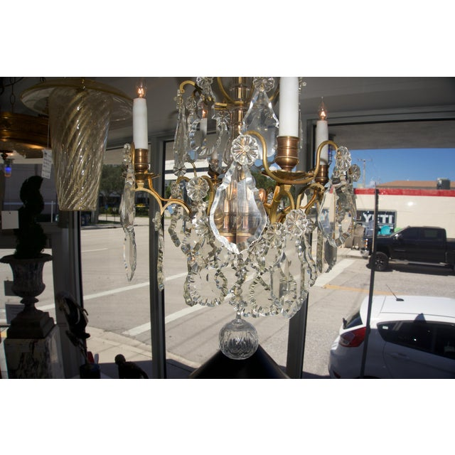 This stylish and chic Louis XV style chandelier was acquired on a buying trip in France and the piece dates to the...