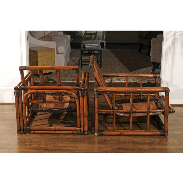 An unusually beautiful pair of cube lounge or club chairs by Ficks Reed, circa 1970. Expertly crafted rattan and hardwood...