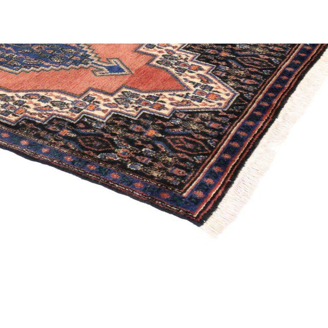 Vintage hand-knotted Persian Sanandaj wool rug featuring a cerulean blue centre medallion and geometric motifs in an open...
