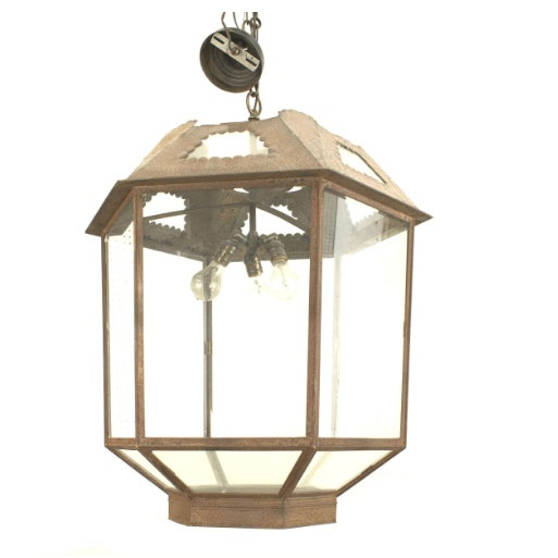 Italian Renaissance style six-sided glass lantern with an iron decorative top section.