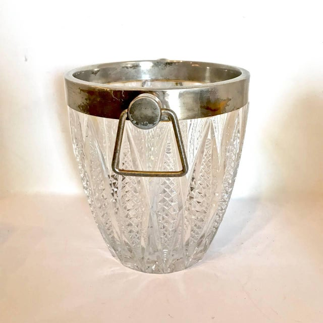 This is a classic 20th century cut crystal and silver plate ice bucket that dates to circa 1950-1960. The bucket is in...